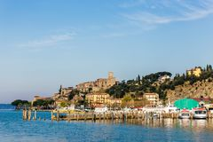 An small medieval village on Lake Trasimeno in Umbria Italy. An small and beautiful medieval village, with its small port, on the shore of Lake Trasimeno in Royalty Free Stock Photo