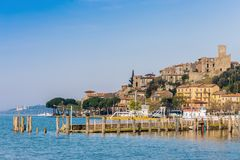 An small medieval village on Lake Trasimeno in Umbria Italy. An small and beautiful medieval village, with its small port, on the shore of Lake Trasimeno in Royalty Free Stock Images