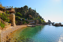 Small mediterranean beach with crystal clear water in summertime. A small city beach at the old town in antalya Stock Photography