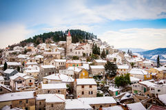 Small Mediterranean town on slopes of hill with church on top Stock Photography
