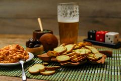 Small melba toast or bruschetta chips on wooden table with beer and sauces royalty free stock photo