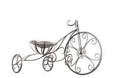 Small metal decorative tricycle close-up. Royalty Free Stock Images