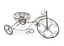 Small metal decorative tricycle. Stock Photo