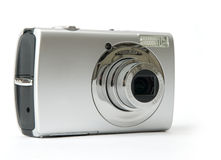 Small metal Digital photo camera. Isolated on white royalty free stock photos
