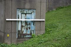 Small metal door on column stock photography