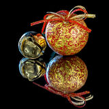 Small metal gold bell and a unique Christmas ornament Royalty Free Stock Image