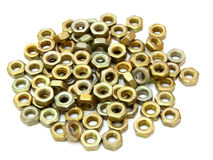 Small metal nuts. On a white background a structure Royalty Free Stock Images
