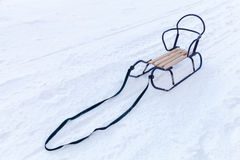 Small metal sled with wooden seat Stock Photography