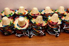 Small mexican hats or sombreros  stacked up on top of each other stock photo