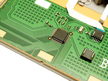 A small microchip on a circuit board Stock Images