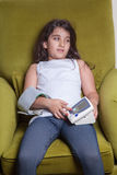 Small middle eastern girl feeling sick bad and holding digital blood pressure device. Stock Photography
