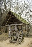 Small mill with a green roof in the forest. Old little mill in the park Shevchenko, Lviv, Ukraine Royalty Free Stock Photo