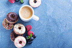 Small mini donuts with fresh berries Stock Photography