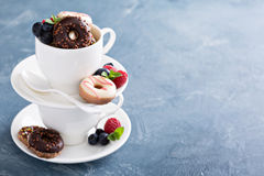 Small mini donuts in stacked coffee cups Royalty Free Stock Photo
