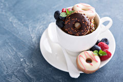 Small mini donuts in stacked coffee cups Royalty Free Stock Image