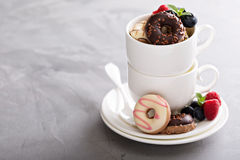 Small mini donuts in stacked coffee cups Stock Photos