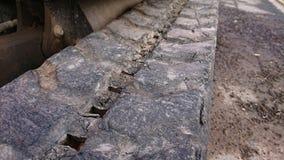 Small Mini Hydraulic Excavator Digger. Closeup of Small Mini Hydraulic Excavator Digger rubber tracks royalty free stock photos