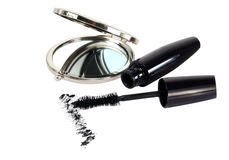 Small mirror and ink for eyelashes Stock Images