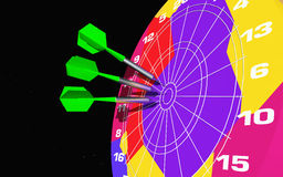 Small missiles in a colorful dartboard Royalty Free Stock Photo