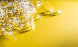 Small 5 mm LEDs on a yellow background, technological process, innovation background. Small 5 mm LEDs on a yellow background, technological process, innovation royalty free stock photography