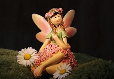 Small model of a fairy decorated with flowers Stock Photography