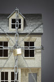 Small model of house chained Royalty Free Stock Photography