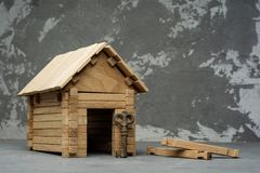Small model of house with key on the concrete background with copy space Stock Image