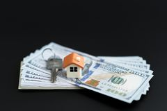 Small Model House and Keys on Newly Designed U.S. One Hundred Dollar Bills. The keys to the purchased house. Reduced copy of the. House on a black background stock images