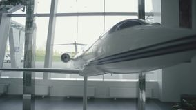 Small model of the plane at the airport stock footage