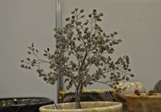 Small model tree made of metal and crystals stock image