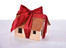Small model of a wooden house tied with a bow Royalty Free Stock Photo