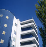Small modern building. Small modern building taken against a brilliant blue sky Stock Image