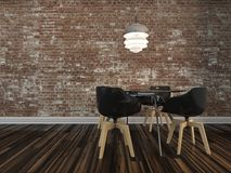 Small modern dining table with rustic brick wall Royalty Free Stock Image