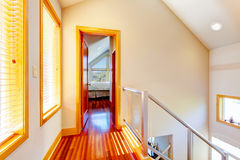 Small modern hallway with metal railings and cherry hardwood flo. Or Royalty Free Stock Images