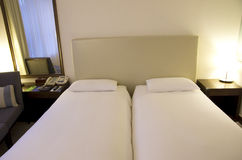 Small modern hotel room beds Royalty Free Stock Photo