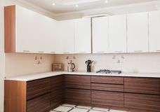 Small modern kitchen in bbrown colour royalty free stock photography