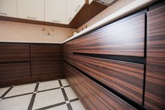 Small modern kitchen in bbrown colour stock photos