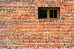 Small modern plastic window on vintage old brick wall Royalty Free Stock Photography