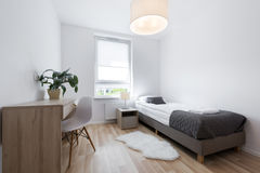 Small, modern sleeping room interior design. In scandinavian style Royalty Free Stock Photo