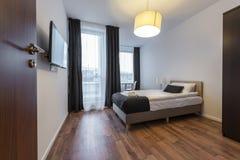 Small, modern sleeping room interior design Royalty Free Stock Photos