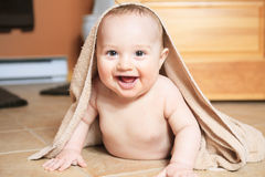 Small 8 months baby after bathing on the floor Stock Image