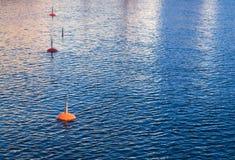 Small mooring buoys. Four small mooring buoys in a harbor Royalty Free Stock Photography