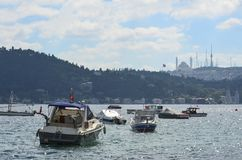 Small motoboats on the Bosphorus on a clear summer day. Istanbul, Turkey stock images