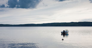 Small motor boat. A small motor boat sitting idle on a lake Stock Images