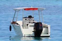 Small motor boat. At rest on tahiti lagoon stock photography