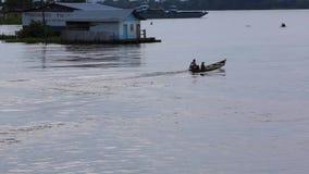 Small motor boat cruising on the Amazon River, Brazil stock video