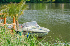 Small motor boat at the dock Stock Photos
