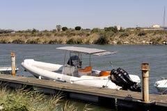 Small motor boat dock Stock Photo