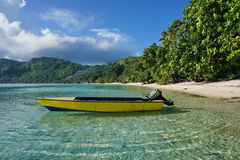 Small motor boat moored on sandy shore Huahine Royalty Free Stock Image