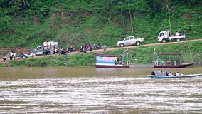 Small motor boat and people activity at the Mekong bank stock video
